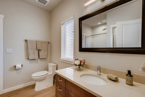 Master bathroom features no curb/low curb showers with flexible hose and non-slip easy to clean floors